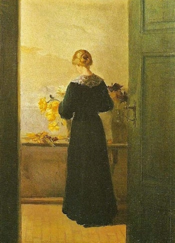 A Young Girl Arranging Flowers by Anna Ancher